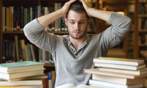Tired student with books